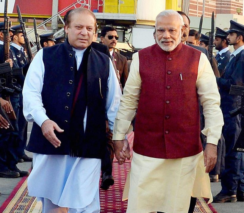 Lahore: Prime Minister Narendra Modi is received by his Pakistani counterpart Nawaz Sharif upon his arrival in Lahore on Friday. PTI Photo (PTI12_25_2015_000218B)